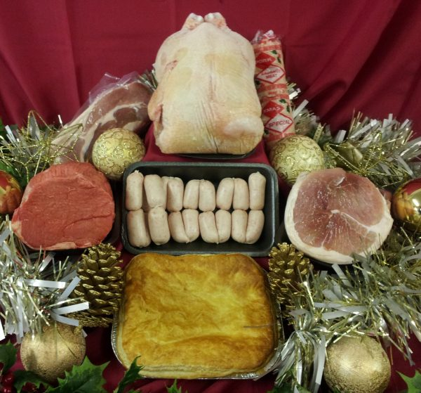 Festive meat hamper containing roasts, steak pie and trimmings