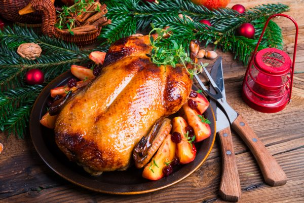 Fresh Roast Duck on Christmas table setting
