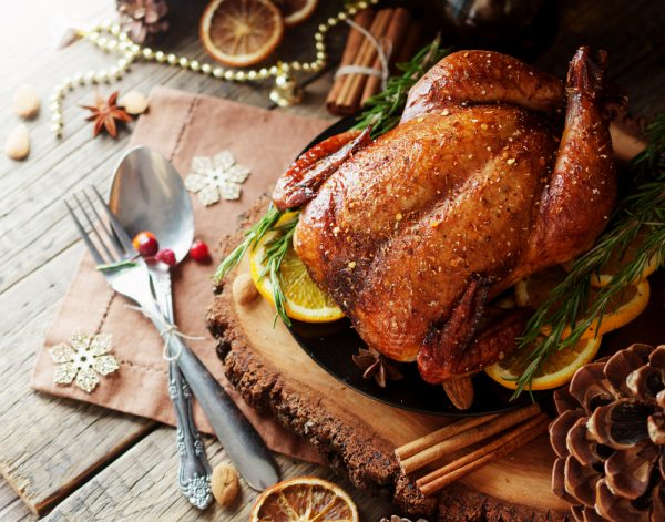Cooked Fresh Capon on Christmas table setting