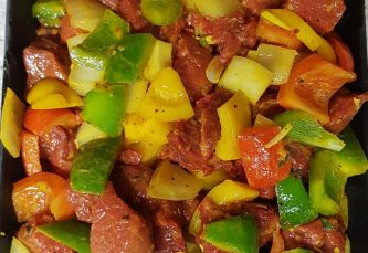 indian style beef curry with chopped peppers and onions
