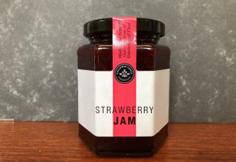 galloway lodge strawberry jam in glass jar on table