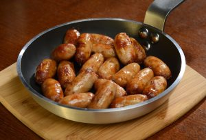 Chipolata Sausages cooked in frying pan